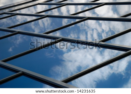 building reflects the sky - stock photo