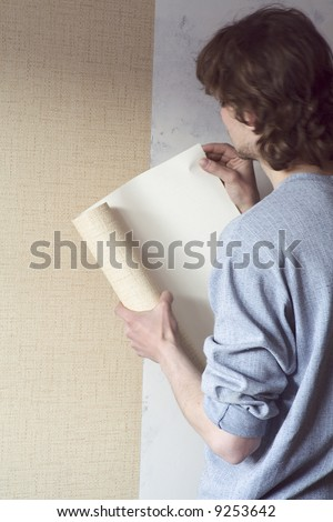 building repairs, decoration with wallpaper. - stock photo