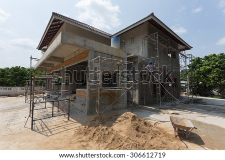 building residential construction house with scaffold steel for construction worker - stock photo