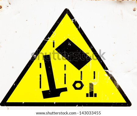 building site danger sign for falling objects with signs of impact on it - stock photo