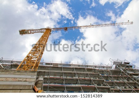 Building site with crane - stock photo