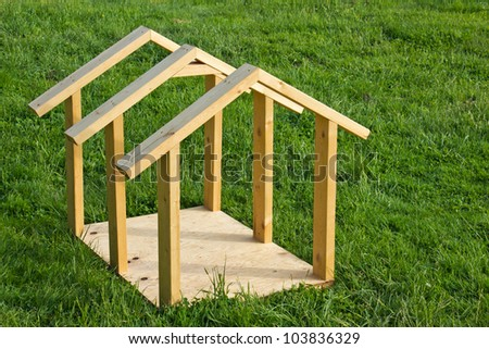 Building small dog house with lumber, frame completed - stock photo