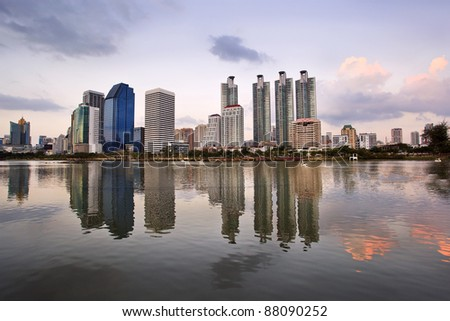 Building suset and water reflection - stock photo