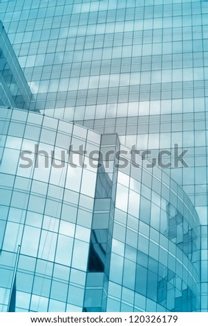 building texture with reflex of sky - stock photo