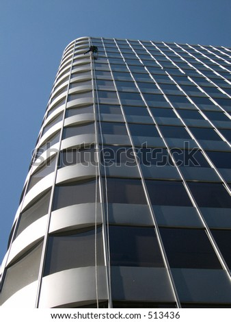 Building texture with window washer - stock photo