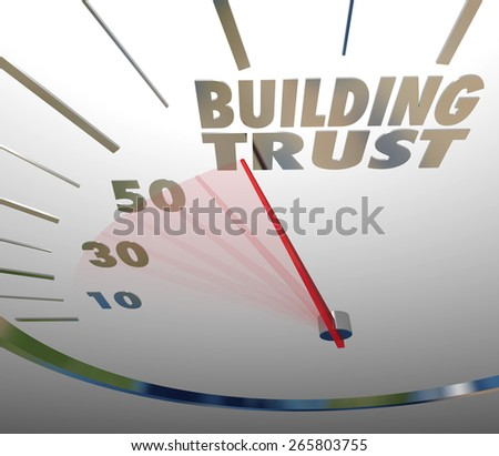 Building Trust words on a speedometer to illustrate a brand company working to establish a reputation and earning customer loyalty and repeat business - stock photo