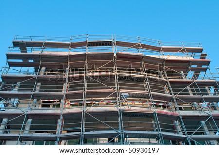 Building under construction blue sky - stock photo