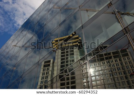 Building under Construction, Blue sky and reflective building - stock photo