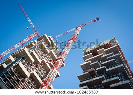 building under construction in a new residential area of Milan - stock photo