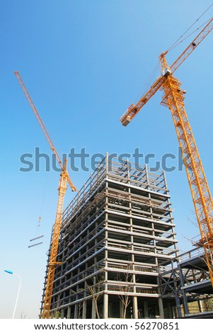 building under construction in perspective - stock photo