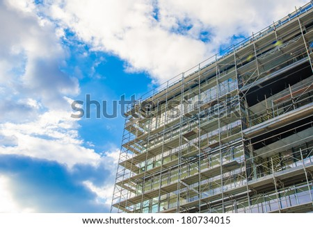 Building under construction on a blue sky sunny day - stock photo