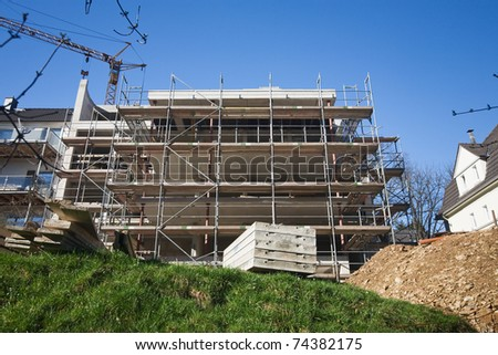 Building under construction with Crane in background - stock photo