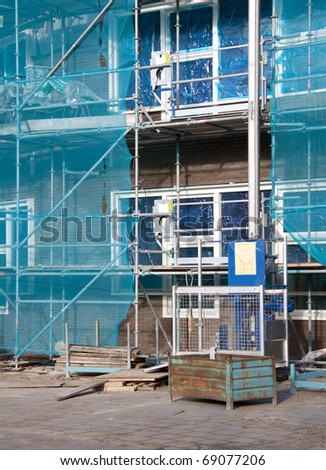 Building under construction with special a elevator - stock photo
