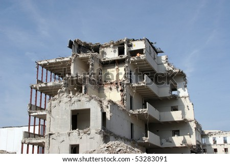 Building under demolition - stock photo