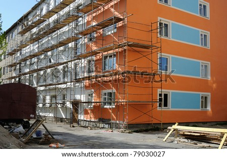 Building under repair and nice evening sunshine. - stock photo
