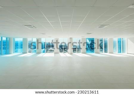 Building, wide open space, skyscraper, windows overlooking the sea - stock photo