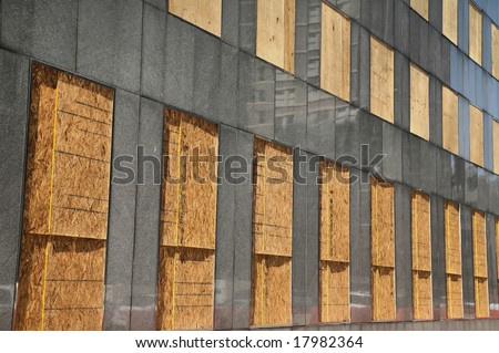 Building Windows all Boarded Up after Hurricane Ike(Release Information: Editorial Use Only. Use of this image in advertising or for promotional purposes is prohibited.) - stock photo