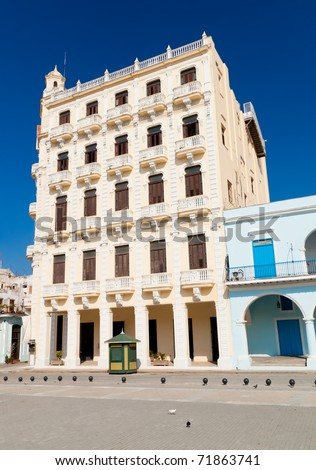 Building with balconies and columns  typical of the architecture of Old Havana - stock photo