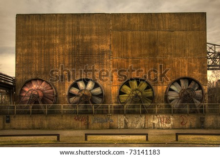 building with big fans from abandoned steelfactory - stock photo