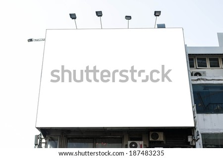 building with blank advertisement billboard - stock photo