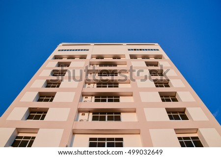 Building with blue sky background.