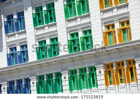 Building with colorful window - stock photo