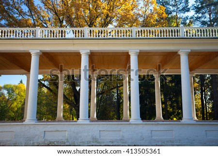building with columns in the park - stock photo