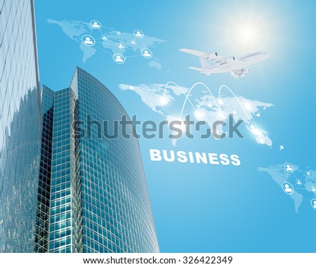 Building with world map and computer icons on blue sky background