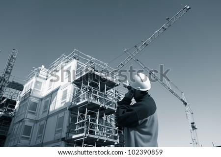 building worker and construction, blue toning idea - stock photo
