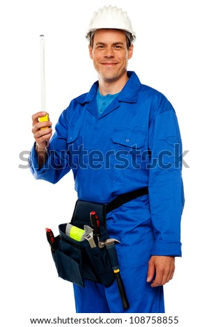 Building worker holding measuring tape isolated over white background - stock photo