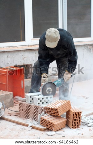Building worker with disc grinder - stock photo