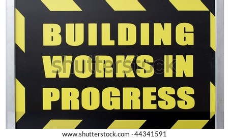 Building works in progress sign isolated over white - (16:9 ratio)
