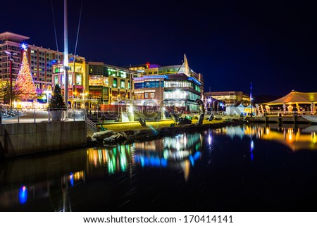 Buildings along the Potomac River waterfront at night, in National Harbor, Maryland. - stock photo