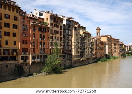 Buildings along the shore the Arno River near Ponte Vecchio in Florence Italy
