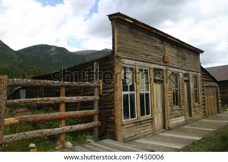Buildings along wooden sidewalk in St. Elmo, Colorado, an historic ghost town in the Rocky Mountains - stock photo