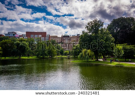Buildings and a pond in the Public Garden in Boston, Massachusetts. - stock photo