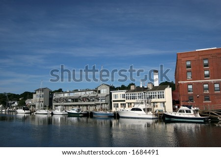 buildings and boats along water in Mystic, Connecticut - stock photo