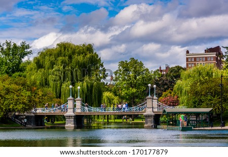 Buildings and bridge over a pond in the Boston Public Garden. - stock photo