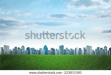 Buildings and green grass field. Architecture background