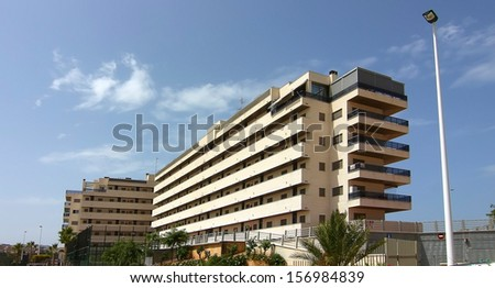 buildings and palm trees typical of the city of Alicante Spain