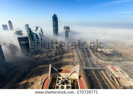 Buildings are covered in thick layer of fog in Business Bay. - stock photo