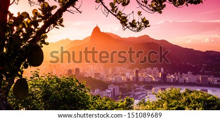 Buildings at the waterfront with Christ The Redeemer statue in the background, Corcovado, Rio de Janeiro, Brazil - stock photo