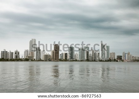 buildings beside sea with cloudy sky background. photography - stock photo