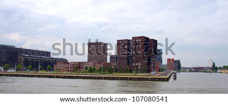 buildings  by  the riverside of the maas river at the city of Rotterdam, in the Netherlands - stock photo