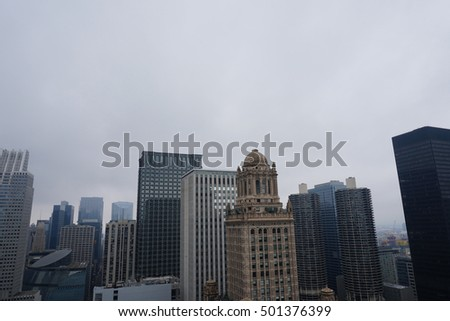 Buildings from the Chicago against foggy and cloudy sky