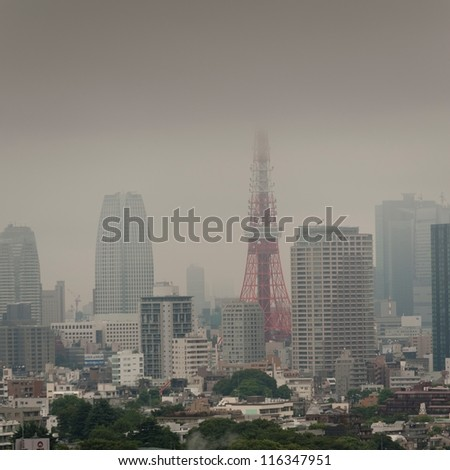 Buildings in a city with Tokyo Tower in the background, Tokyo, Japan