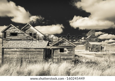 Buildings in an abandoned ghost town of Bents, Saskatchewan, Canada.  Processed with an infrared filter. - stock photo