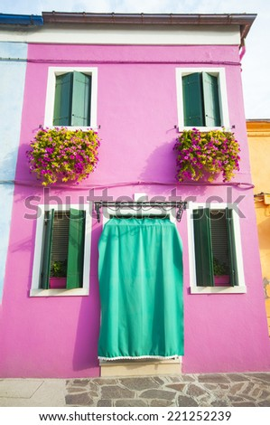 Buildings in Burano, an island full of colors in the lagoon near Venice  - stock photo