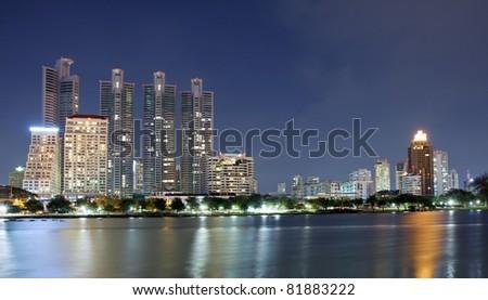 Buildings in downtown Bangkok at night. Bangkok, Thailand. - stock photo