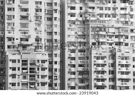 Buildings in Macau (China's Special Administrative Region) with different types of windows or extensions built by the residents. - stock photo